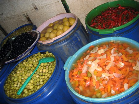 Pickled vegetables in blue tubs