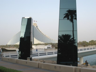 Reflections in foreground against Al Jumeirah Beach Hotel Dubai