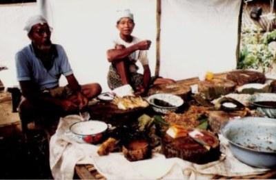 Resting cooks at Bali village wedding feast preparation