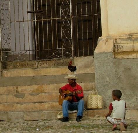 Rooster on hat of  musician Trinidad de Cuba