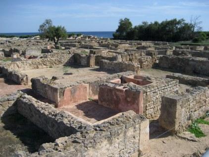 Ruins of Kerkouane houses beside the ocean in Tunisia