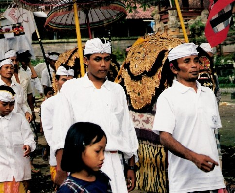 Serious marchers in ceremonial procession at Village of White Herons in Bali