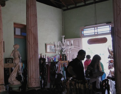 Shoppers in living room shop Trinidad de Cuba