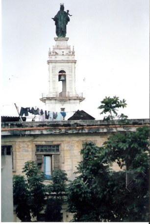 Statue of the Holy Mother in Havana with washing hanging out