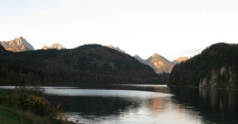 Sunrise-tipped mountains Alpsee Bavaria