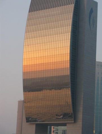 Sunset reflections on the National Bank of Dubai from Dubai Creek