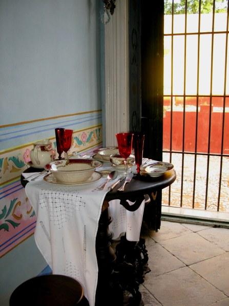 Table setting in antique shop in Trinidad de Cuba