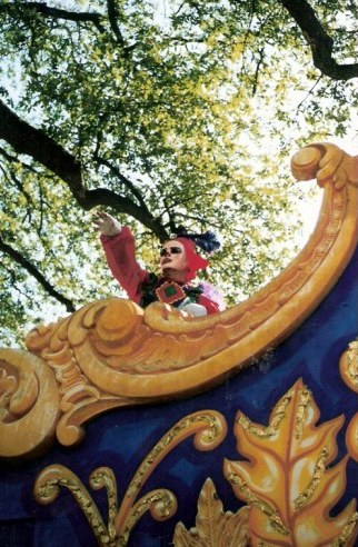 Throwing beads New Orleans Mardi Gras