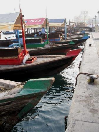 Traditional wooden dhows abras or water taxis on Dubai Creek