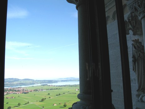 View guarded by statue of Holy Mother from Neuschwanstein Castle Bavaria