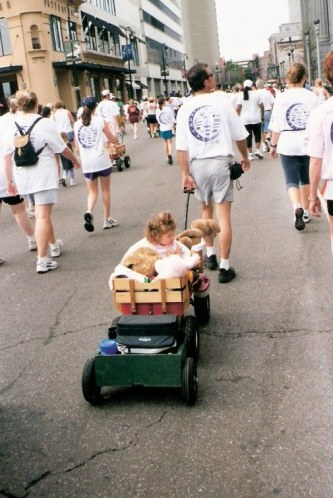 Walkers with children in wagons in the New Orleans Marathon