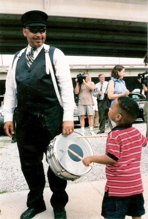 Young drummer playing Jazz Funeral New Orleans