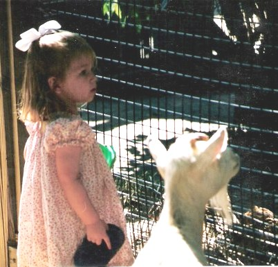 Young girl and goat at the Audubon Zoo New Orleans