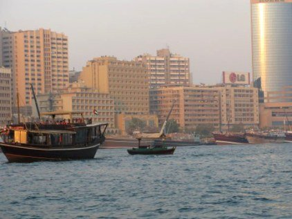 Busy wooden dhows on Dubai Creek