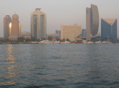 Etisilat Tower with golden sunset reflections from Dubai Creek