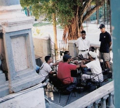 Game of Dominoes on verandah in Havana, Cuba