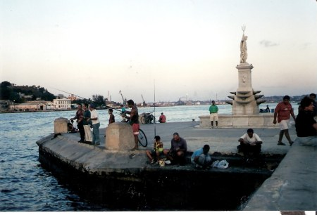 Havana-fishing-by-statue-of-Poseidon-Malecon