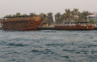 Large and small dhow on Dubai Creek