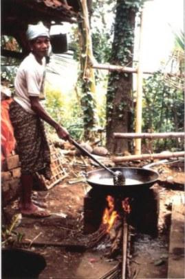 Man tending pork fat soup for Balinese village wedding