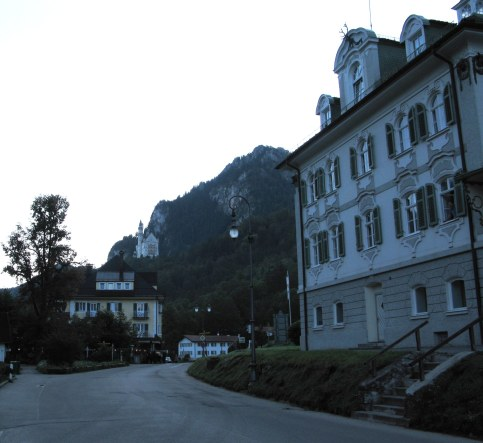 Neunschwanstein Castle above Hotel Müller-at-dusk