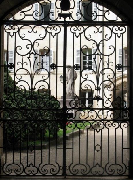 Ornamental garden gate and sculpture Hospices de Beaune