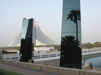 Reflections in foreground against Al Jumeirah Beach Hotel Dubai