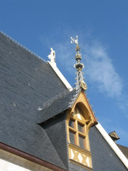 Saint on chapel roof of the Hospices de Beaune